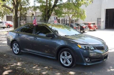 2014 Toyota Camry for sale at SUPER DEAL MOTORS in Hollywood FL