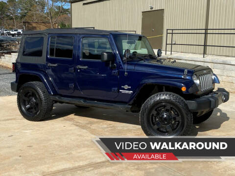 2012 Jeep Wrangler Unlimited for sale at Selective Imports in Woodstock GA
