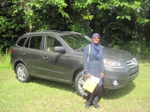 2012 Hyundai Santa Fe for sale at HOGSTEN AUTO WHOLESALE in Ocala FL