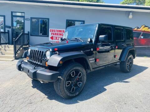 2012 Jeep Wrangler Unlimited for sale at M&M's Auto Sales & Detail in Kansas City KS