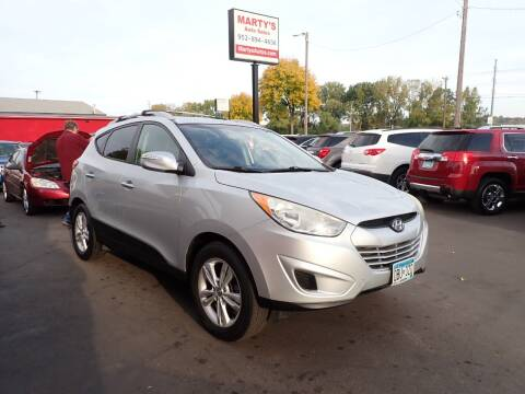 2012 Hyundai Tucson for sale at Marty's Auto Sales in Savage MN