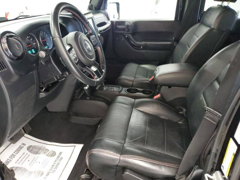 2012 Jeep Wrangler Unlimited for sale at G. B. ENTERPRISES LLC in Crossville AL