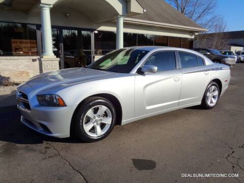 2012 Dodge Charger for sale at DEALS UNLIMITED INC in Portage MI