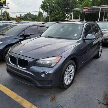 2014 BMW X1 for sale at America Auto Wholesale Inc in Miami FL