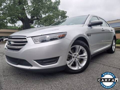 2016 Ford Taurus for sale at Carma Auto Group in Duluth GA