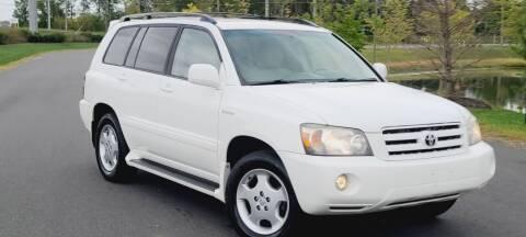 2005 Toyota Highlander for sale at BOOST MOTORS LLC in Sterling VA