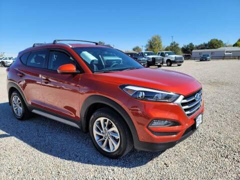 2017 Hyundai Tucson for sale at BERKENKOTTER MOTORS in Brighton CO