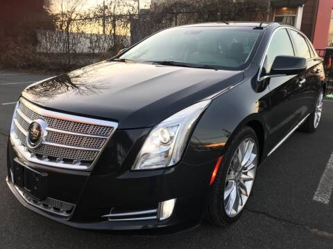 2014 Cadillac XTS for sale at MAGIC AUTO SALES in Little Ferry NJ