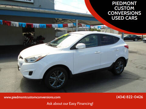 2015 Hyundai Tucson for sale at PIEDMONT CUSTOM CONVERSIONS USED CARS in Danville VA