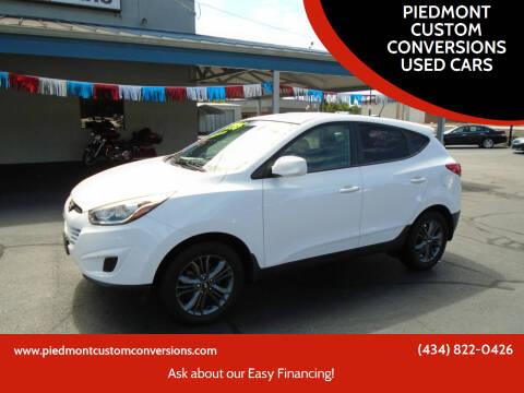 2015 Hyundai Tucson for sale at PIEDMONT CUSTOM CONVERSIONS USED CARS in Danville VA
