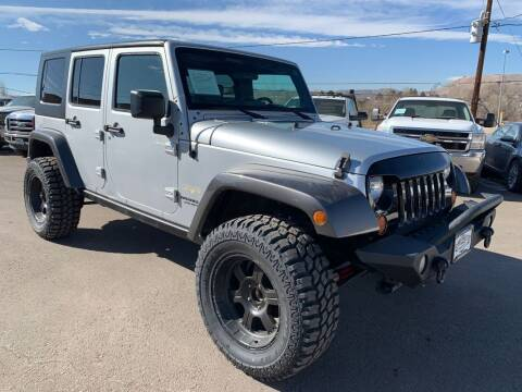 2008 Jeep Wrangler Unlimited for sale at BERKENKOTTER MOTORS in Brighton CO