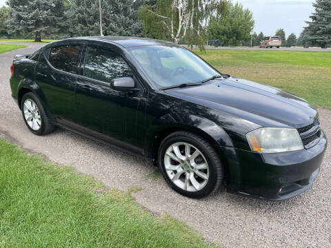 2013 Dodge Avenger for sale at BELOW BOOK AUTO SALES in Idaho Falls ID