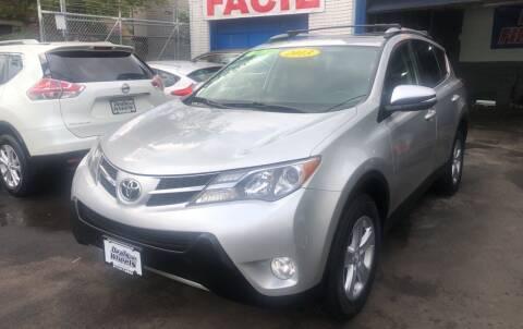 2013 Toyota RAV4 for sale at DEALS ON WHEELS in Newark NJ