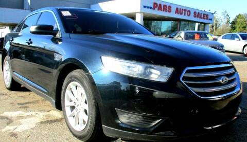 2014 Ford Taurus for sale at Pars Auto Sales Inc in Stone Mountain GA
