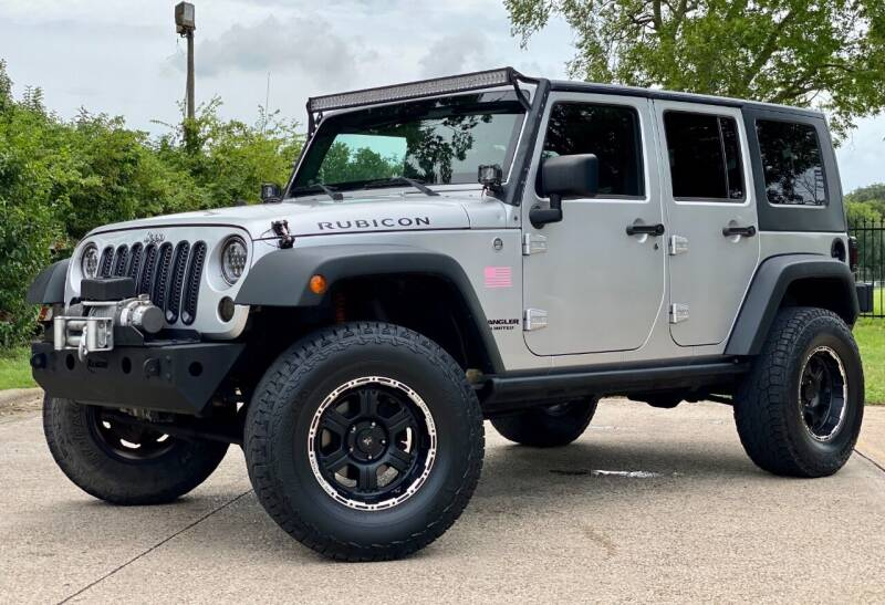 2010 Jeep Wrangler Unlimited for sale at Texas Auto Corporation in Houston TX