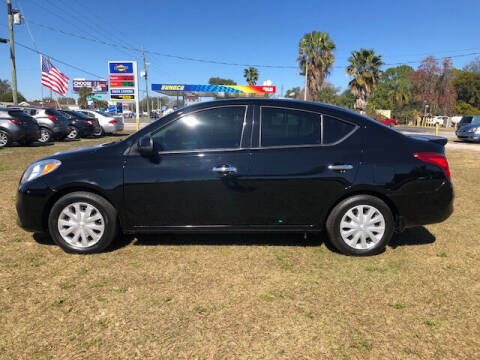 2014 Nissan Versa for sale at Unique Motor Sport Sales in Kissimmee FL