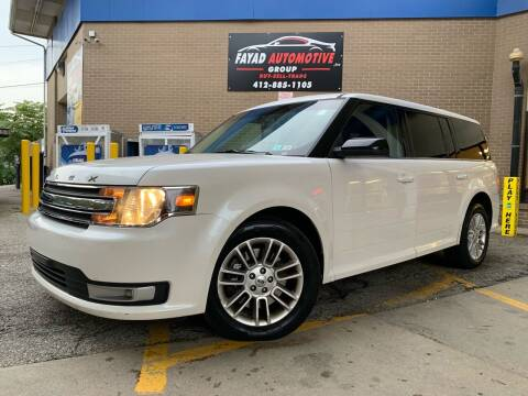 2013 Ford Flex for sale at FAYAD AUTOMOTIVE GROUP in Pittsburgh PA