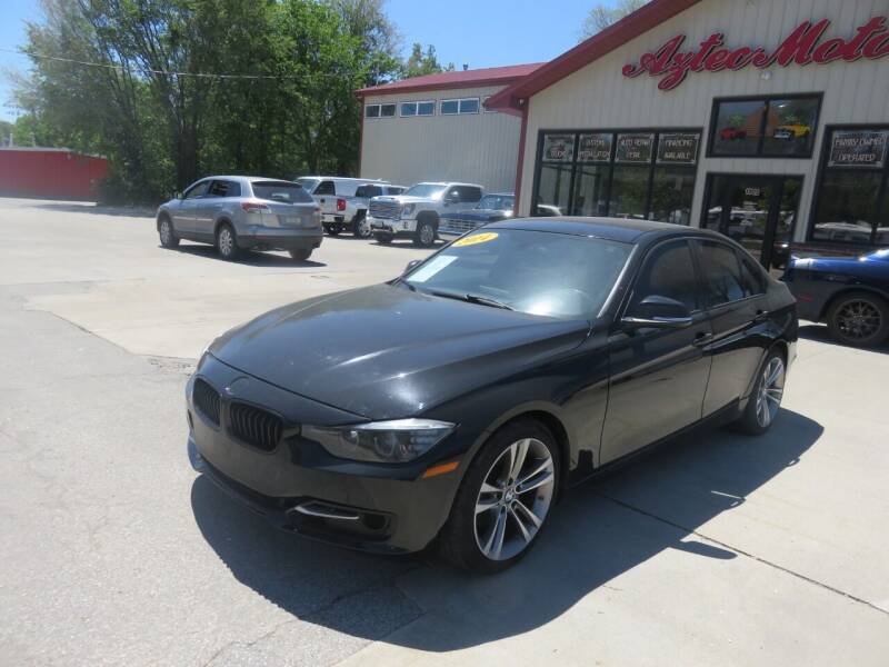 2014 BMW 3 Series for sale at Azteca Auto Sales LLC in Des Moines IA