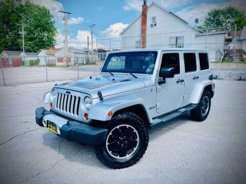 2012 Jeep Wrangler Unlimited for sale at ARCH AUTO SALES in St. Louis MO