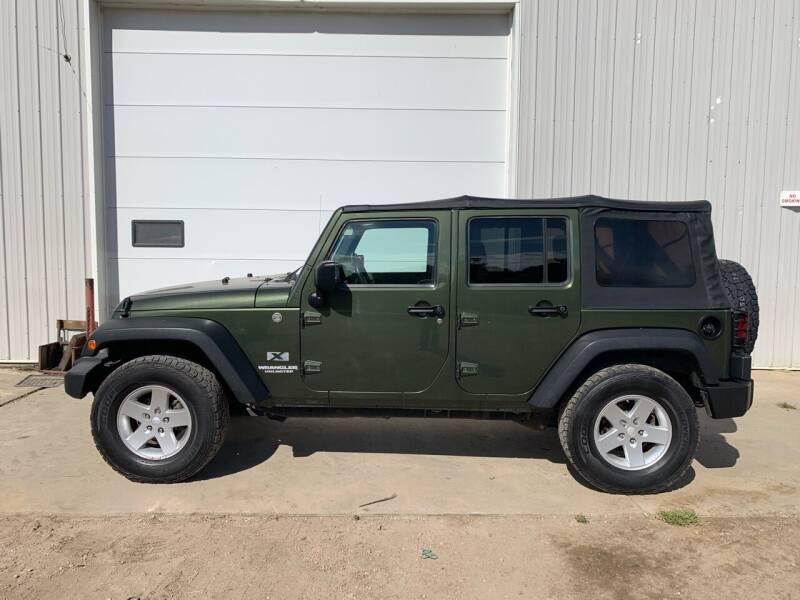 2009 Jeep Wrangler Unlimited for sale at RMI in Chancellor SD