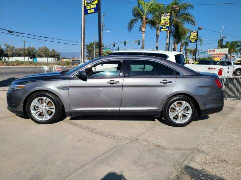 2013 Ford Taurus for sale at E and M Auto Sales in Bloomington CA