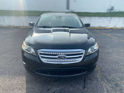 2011 Ford Taurus for sale at D & J's Automotive Sales LLC in Olathe KS