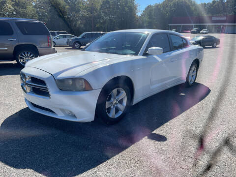 2014 Dodge Charger for sale at Certified Motors LLC in Mableton GA