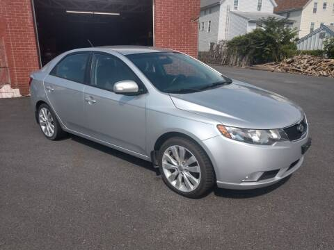 2010 Kia Forte for sale at A J Auto Sales in Fall River MA