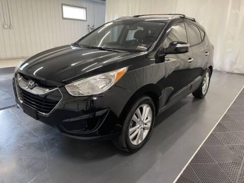 2011 Hyundai Tucson for sale at Monster Motors in Michigan Center MI