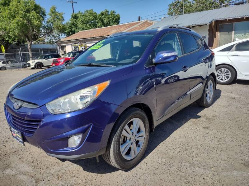 2013 Hyundai Tucson for sale at Larry's Auto Sales Inc. in Fresno CA