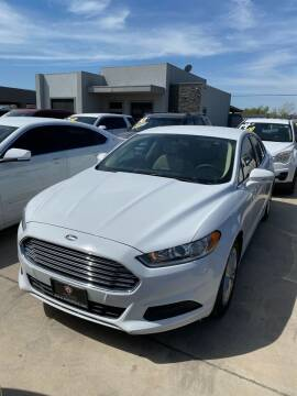 2014 Ford Fusion for sale at A & V MOTORS in Hidalgo TX