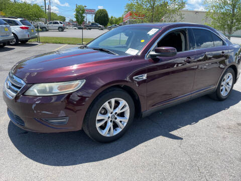 2011 Ford Taurus for sale at Diana Rico LLC in Dalton GA