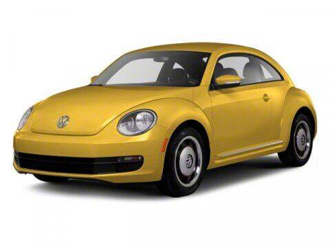 2012 Volkswagen Beetle for sale at HILAND TOYOTA in Moline IL