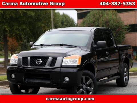 2012 Nissan Titan for sale at Carma Auto Group in Duluth GA