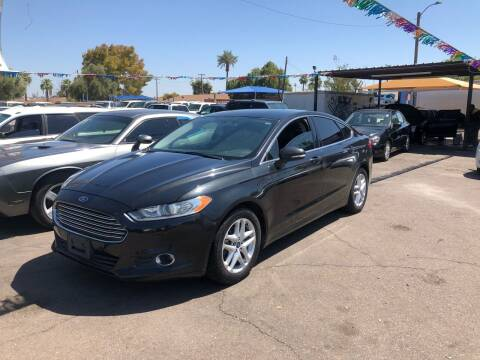 2013 Ford Fusion for sale at Valley Auto Center in Phoenix AZ