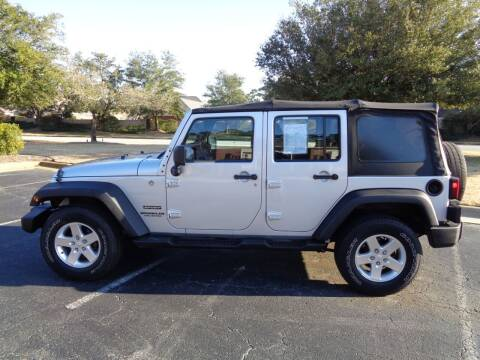 2012 Jeep Wrangler Unlimited for sale at BALKCUM AUTO INC in Wilmington NC