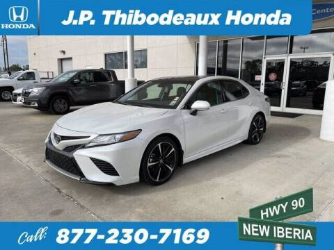 2018 Toyota Camry for sale at J P Thibodeaux Used Cars in New Iberia LA