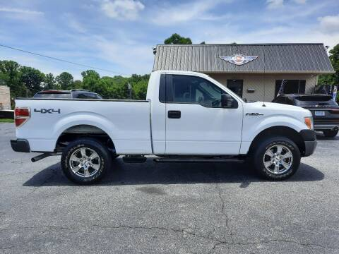 2011 Ford F-150 for sale at G AND J MOTORS in Elkin NC
