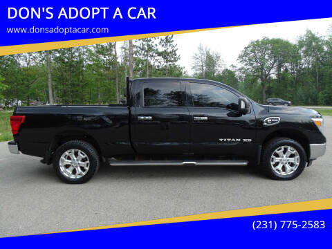 2016 Nissan Titan XD for sale at DON'S ADOPT A CAR in Cadillac MI