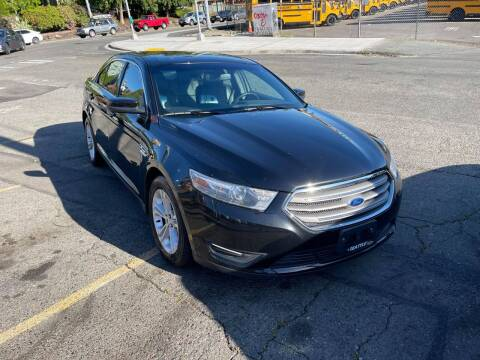 2014 Ford Taurus for sale at SNS AUTO SALES in Seattle WA