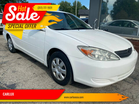 2003 Toyota Camry for sale at CARLUX in Fortville IN