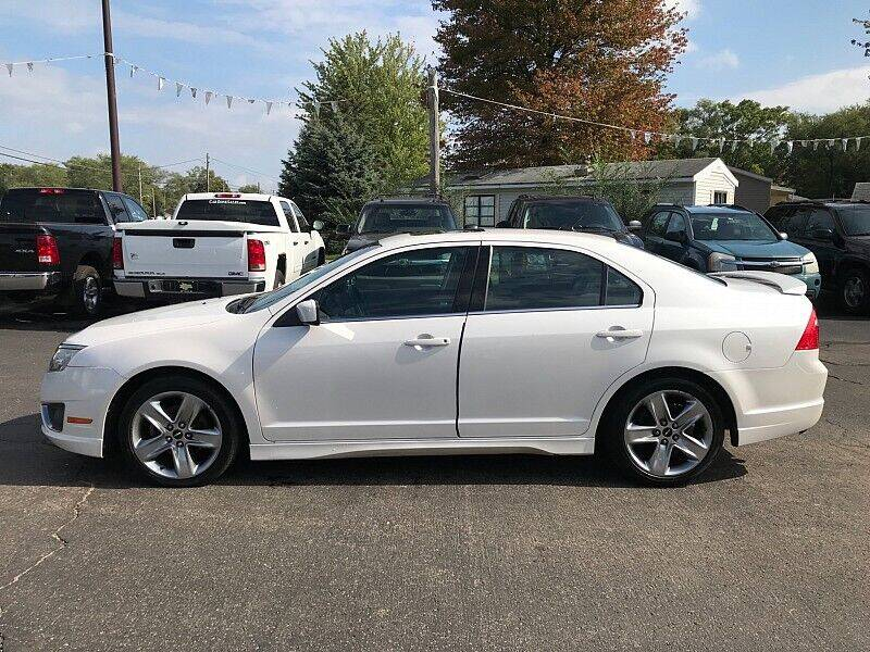 2011 Ford Fusion for sale at Car Zone in Otsego MI
