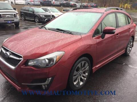 2016 Subaru Impreza for sale at J & M Automotive in Naugatuck CT