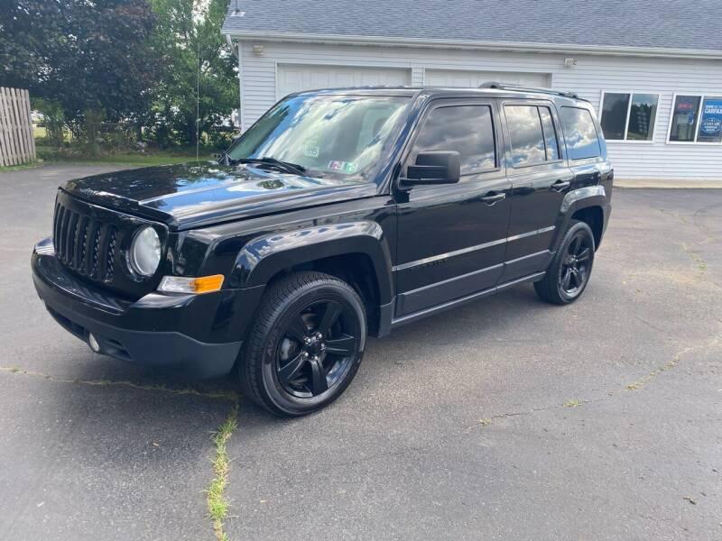 2014 Jeep Patriot for sale at Rombaugh's Auto Sales in Battle Creek MI