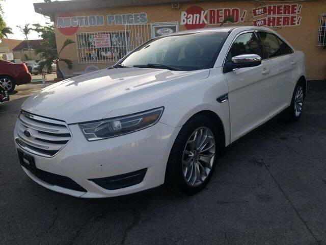 2014 Ford Taurus for sale at VALDO AUTO SALES in Hialeah FL