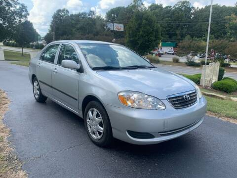 2007 Toyota Corolla for sale at Alfa Auto Sales in Raleigh NC
