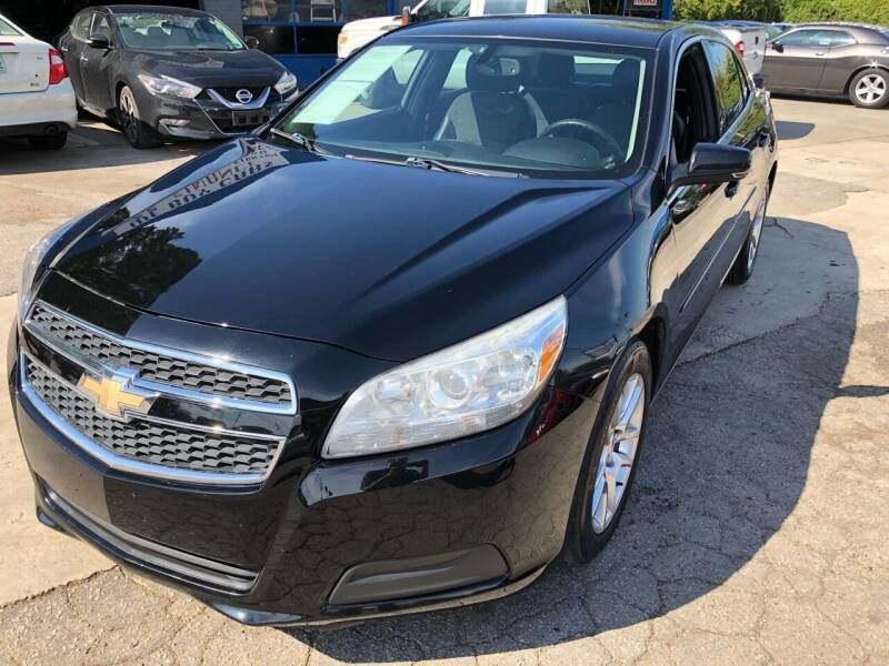 2013 Chevrolet Malibu for sale at Capital Motors in Raleigh NC