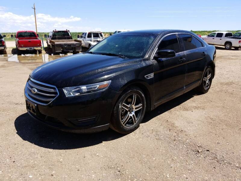 2014 Ford Taurus for sale at HORSEPOWER AUTO BROKERS in Fort Collins CO