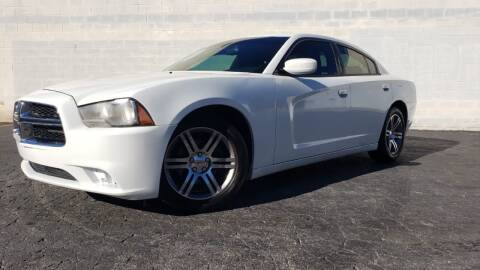 2014 Dodge Charger for sale at AUTO FIESTA in Norcross GA