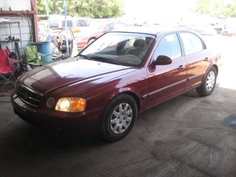 2006 Kia Optima for sale at CARZ R US 1 in Armington IL